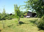 Gartengrundstück mit Blockbohlenhaus