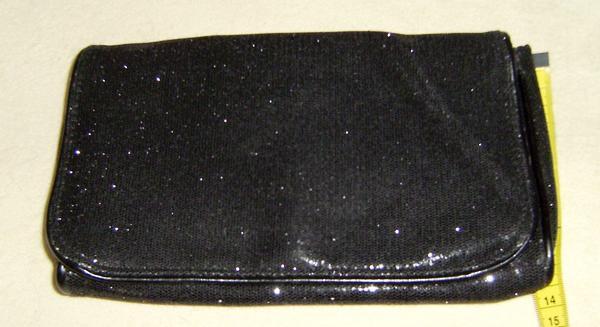 Clutch in schwarz /glitzer - Worms Hochheim - Clutch in schwarz /glitzerEine umwerfend,schöne rechteckige Clutch in schwarz mit Glitzer- Effekt. Mit Magnetverschluss und einer Tasche im Innenfach die mit einem Reißverschluss zu schließen ist. Es wirkt als ob sie Lurex in sich hat, - Worms Hochheim